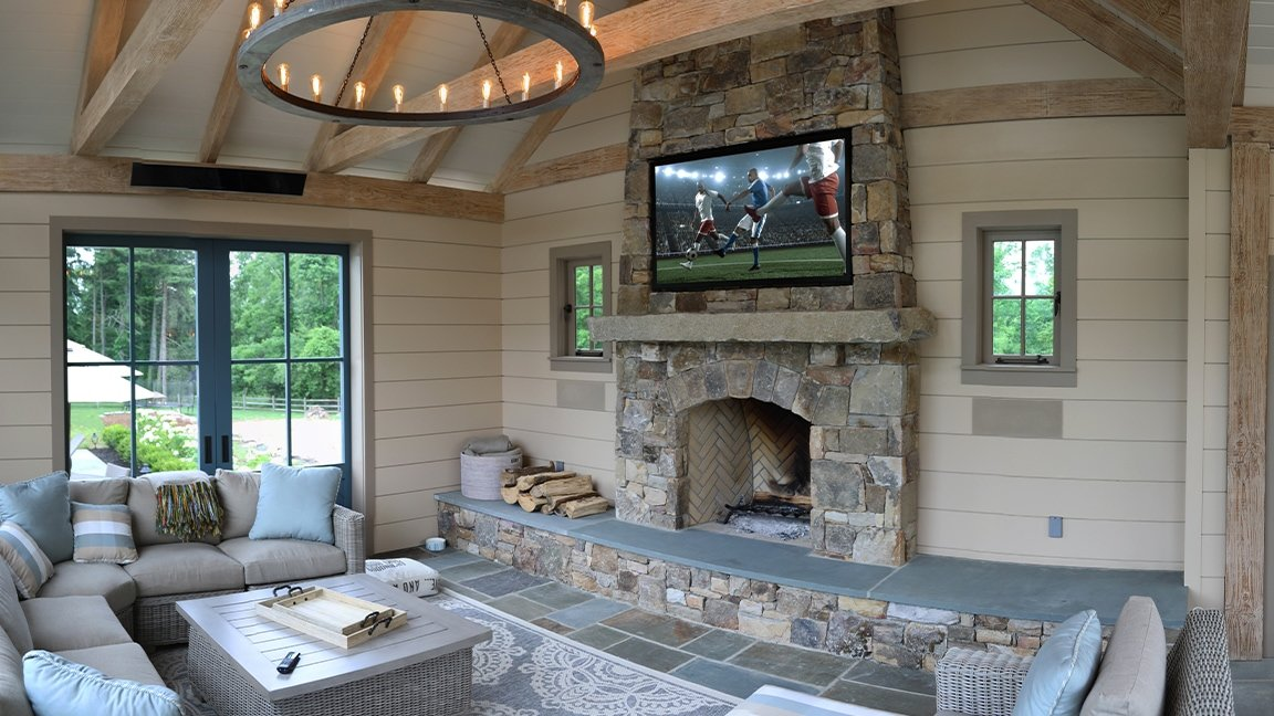 Outdoor TV and speakers in pool house